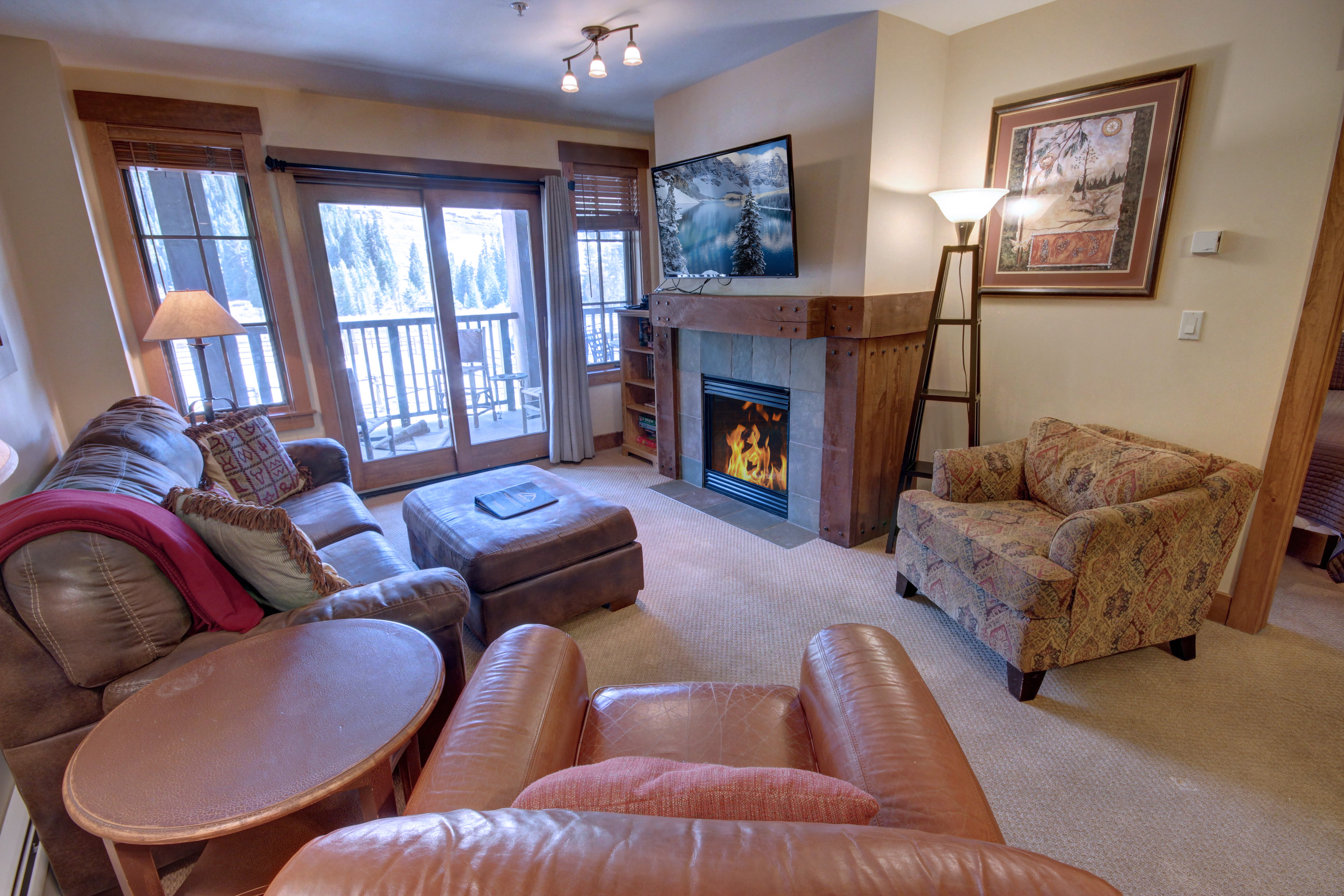 A open living room with a great view of the mountains with patio access