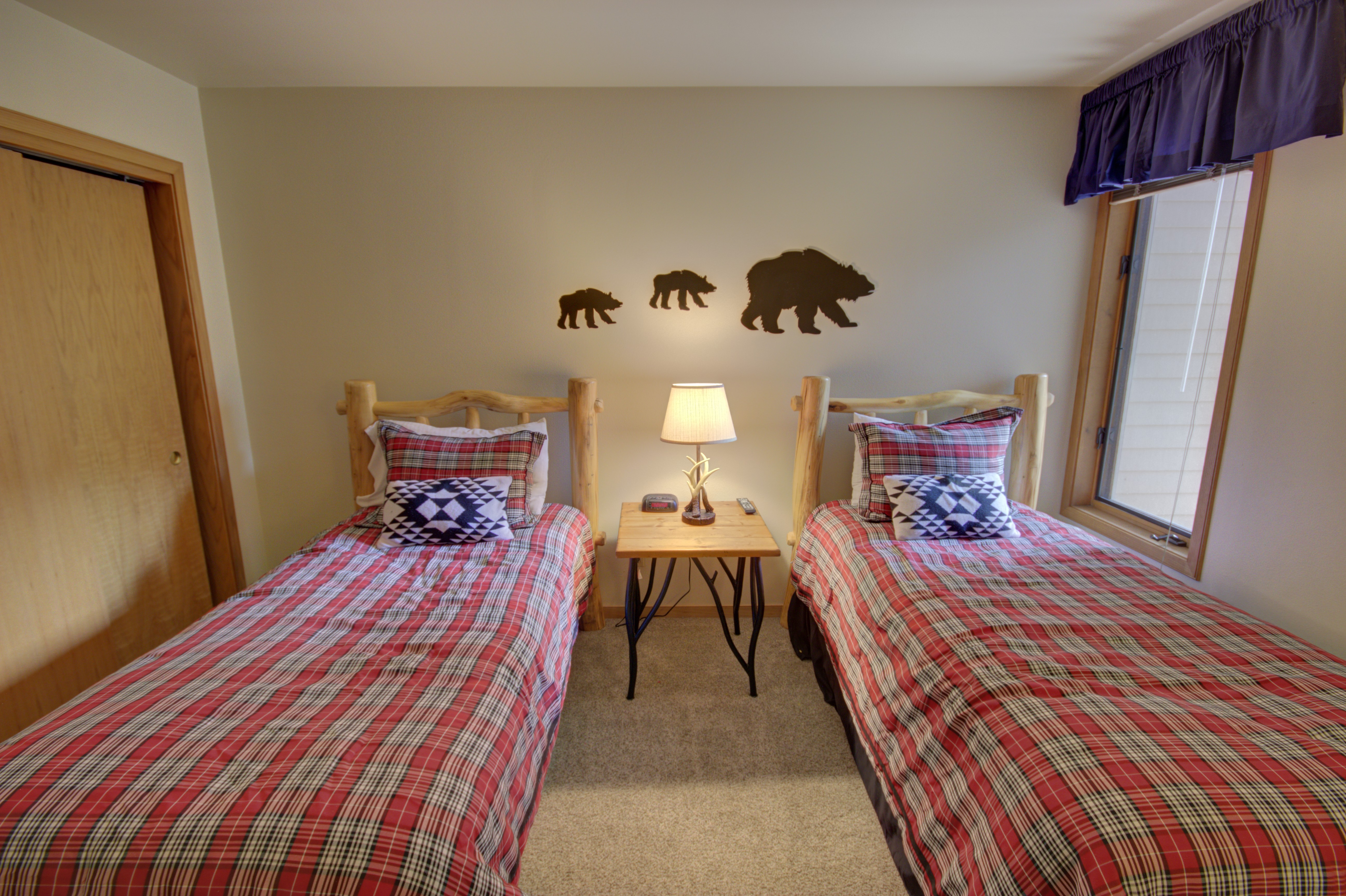 Bedroom perfect for the kids and has super cute wall decor