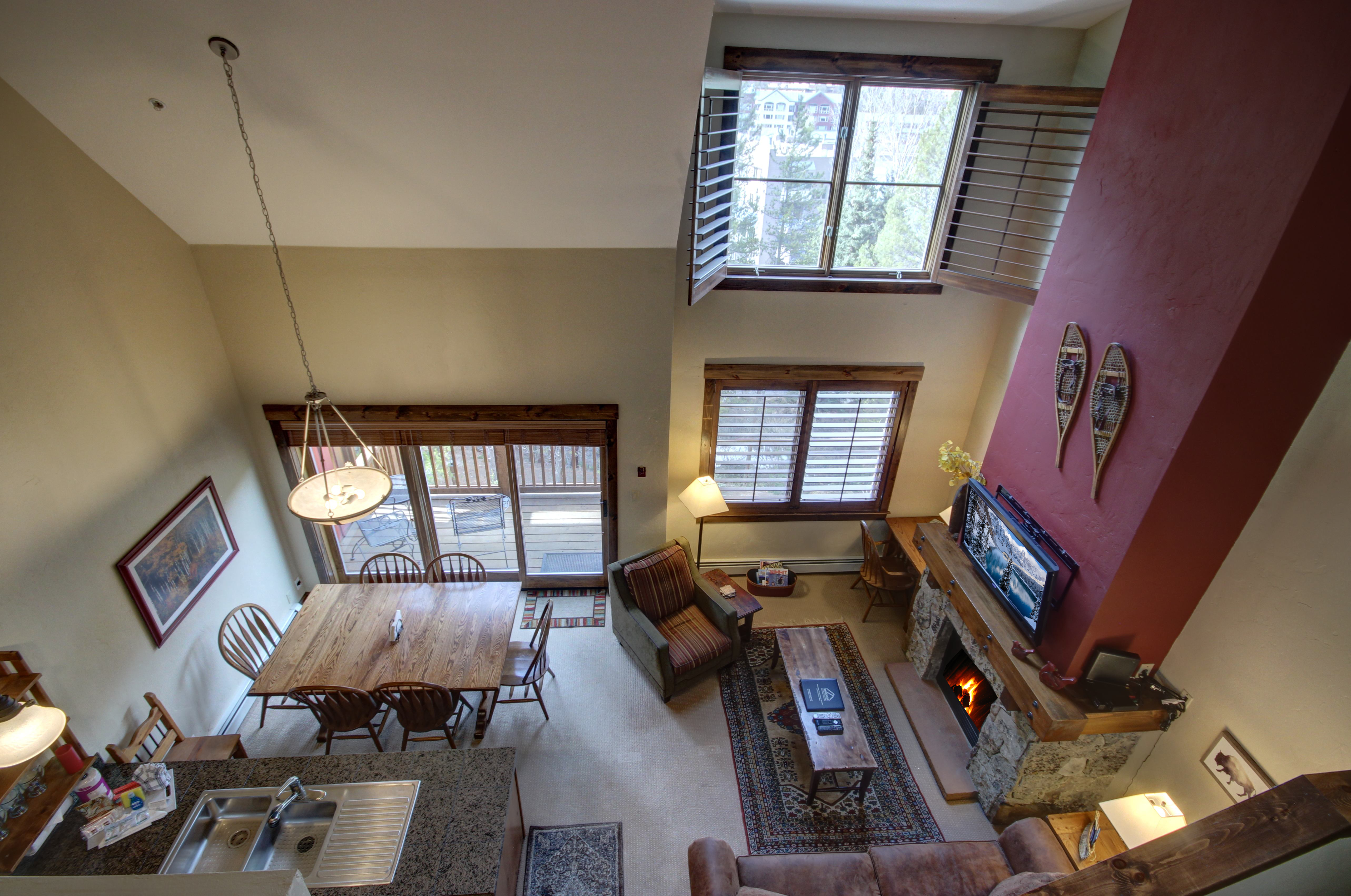 Living room, dining area and kitchen with overlooking balcony