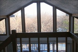 Great view out of window wall from upper level bedroom