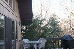 Large wrap around deck with BBQ grill and outdoor seating