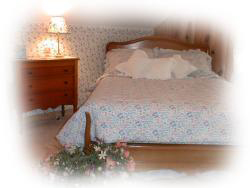 The double bed has a floral comforter with spring flowers