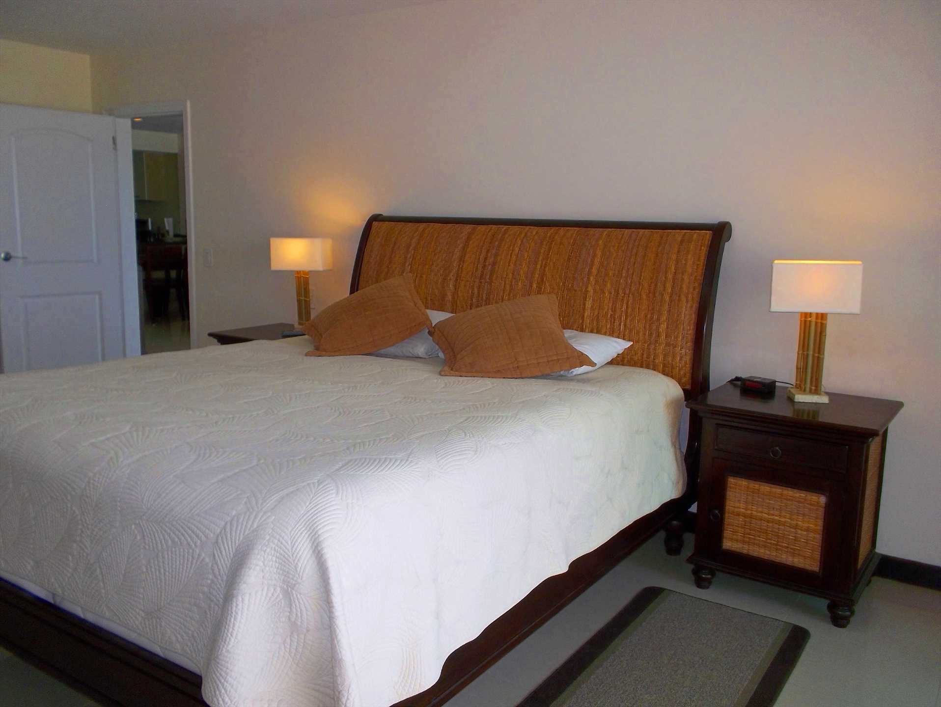Master bedroom with Sealy PosturepedicA- mattress king-size bed.