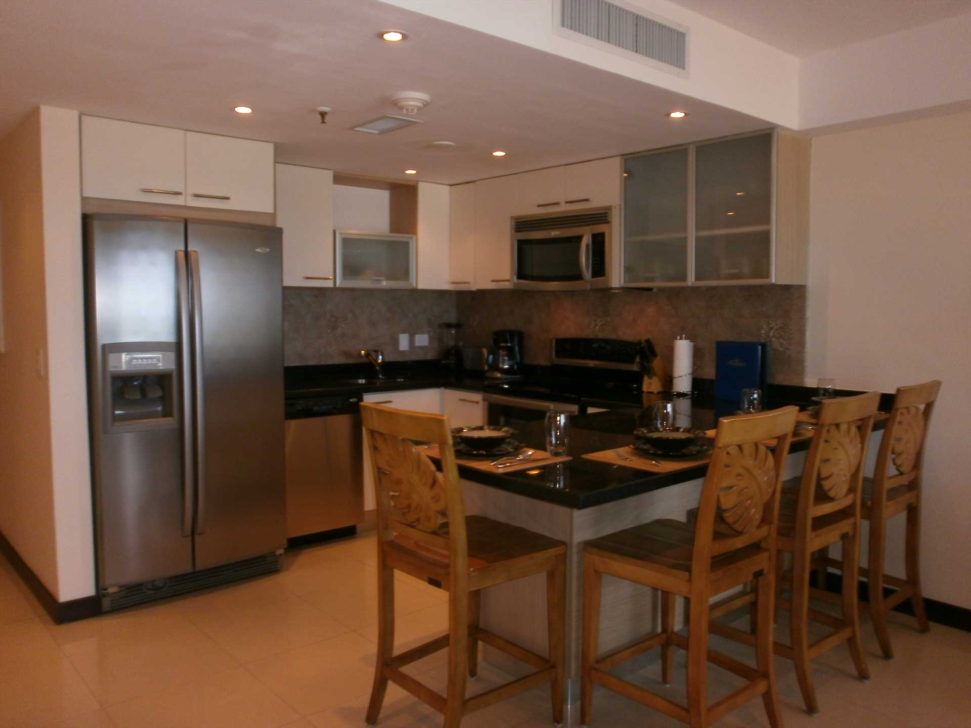 Fully equipped modern kitchen with 4-bar seats