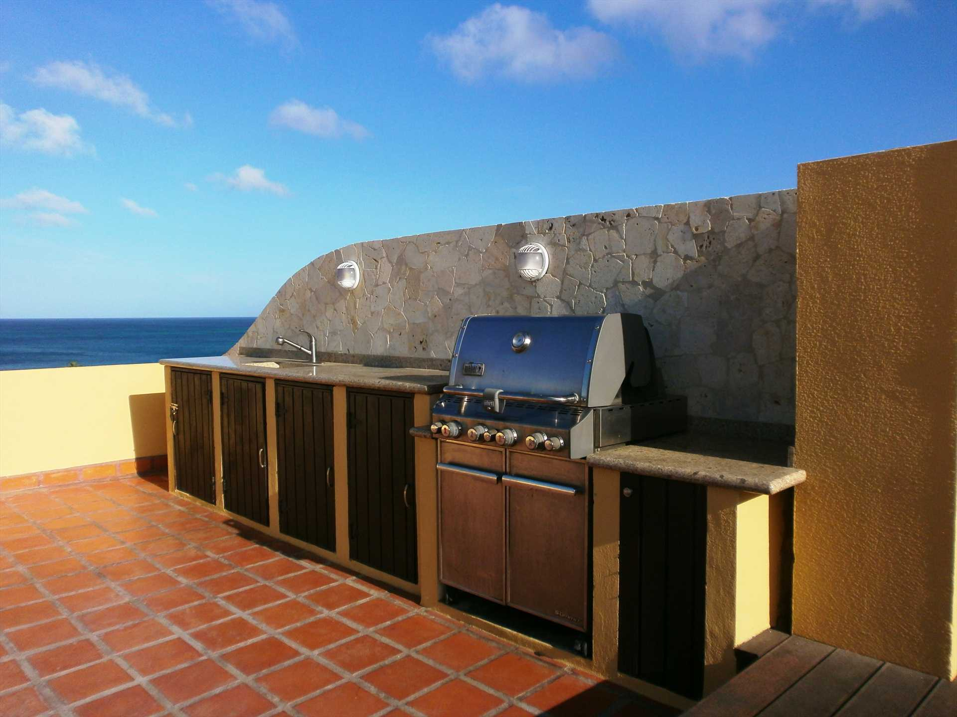 Outdoor kitchen with built-in WEBER gas BBQ grill and refrigerator!