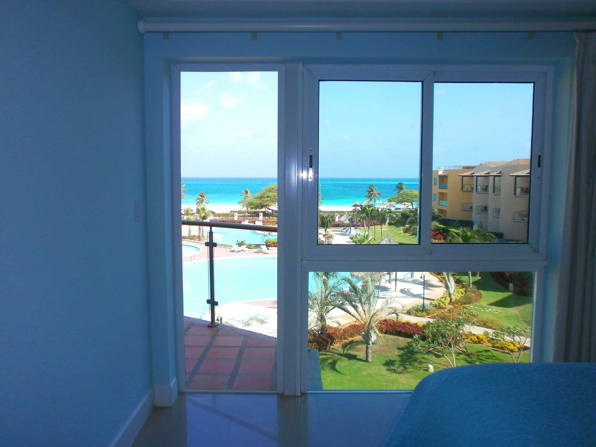 Direct access to balcony from master bedroom with spectacular ocean view!