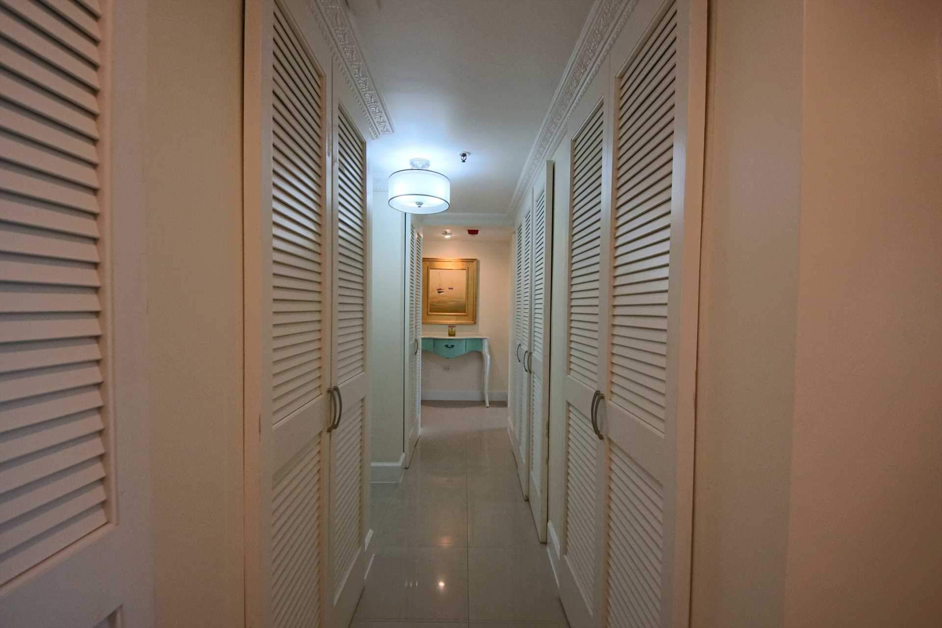 Corridor that lends access to laundry, third full bathroom & bedrooms