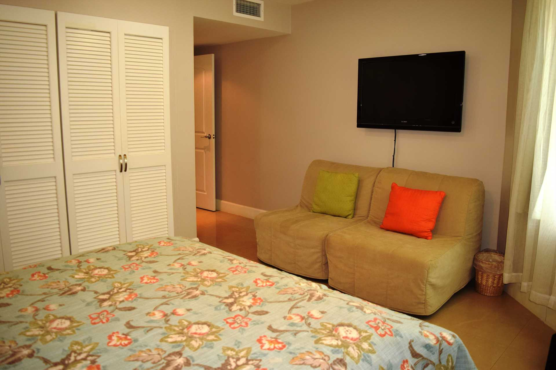 Second bedroom with two single sofa-beds and HD flatscreen TV