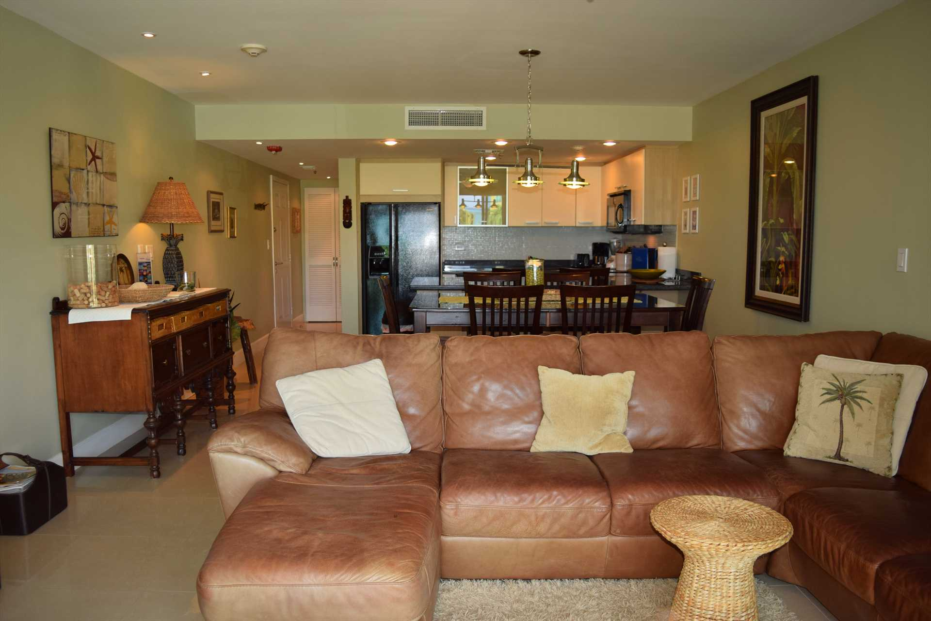 Spacious living/dining area with open kitchen.