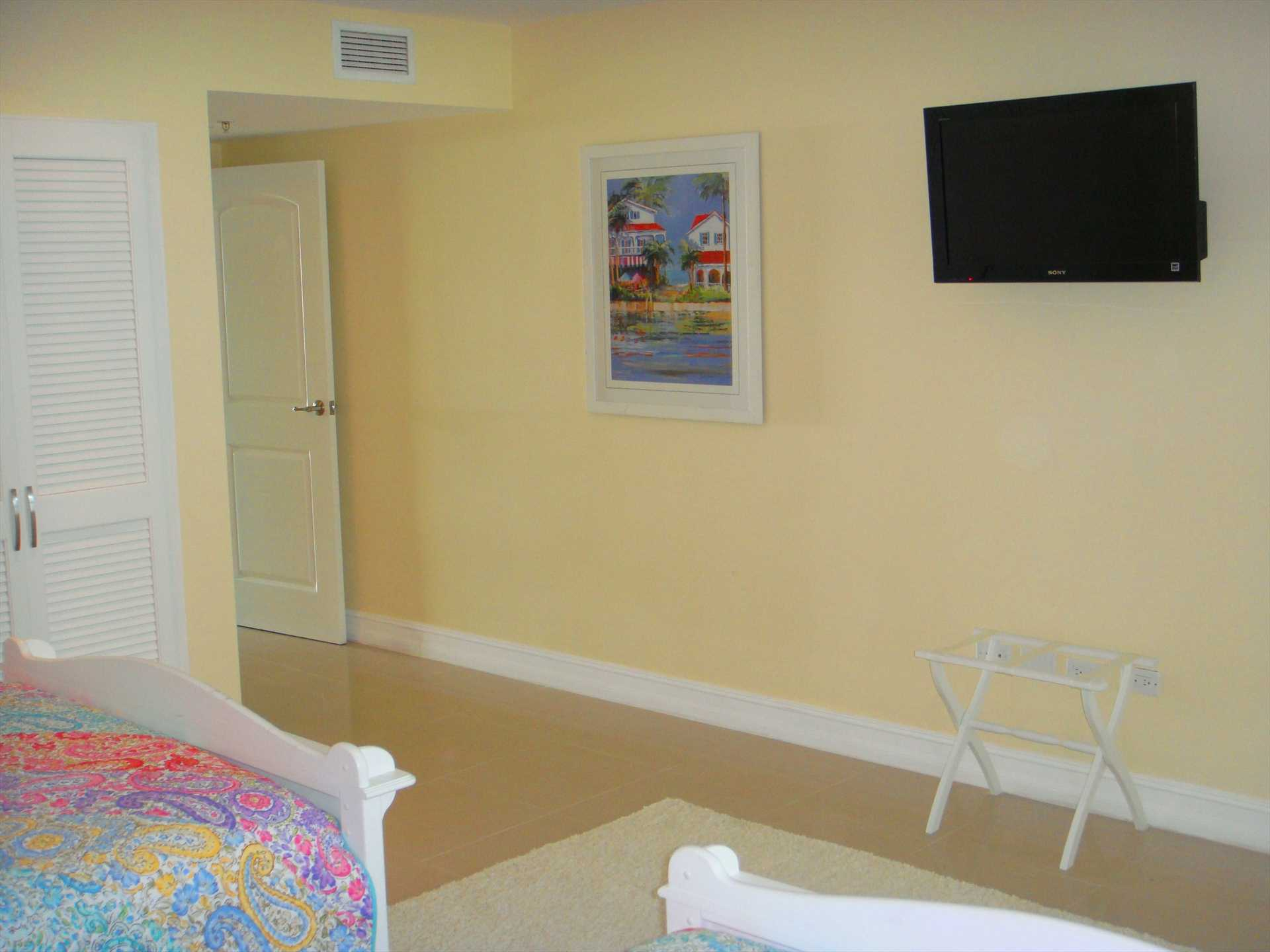 Relax and watch your flatscreen HDTV in the third bedroom too!