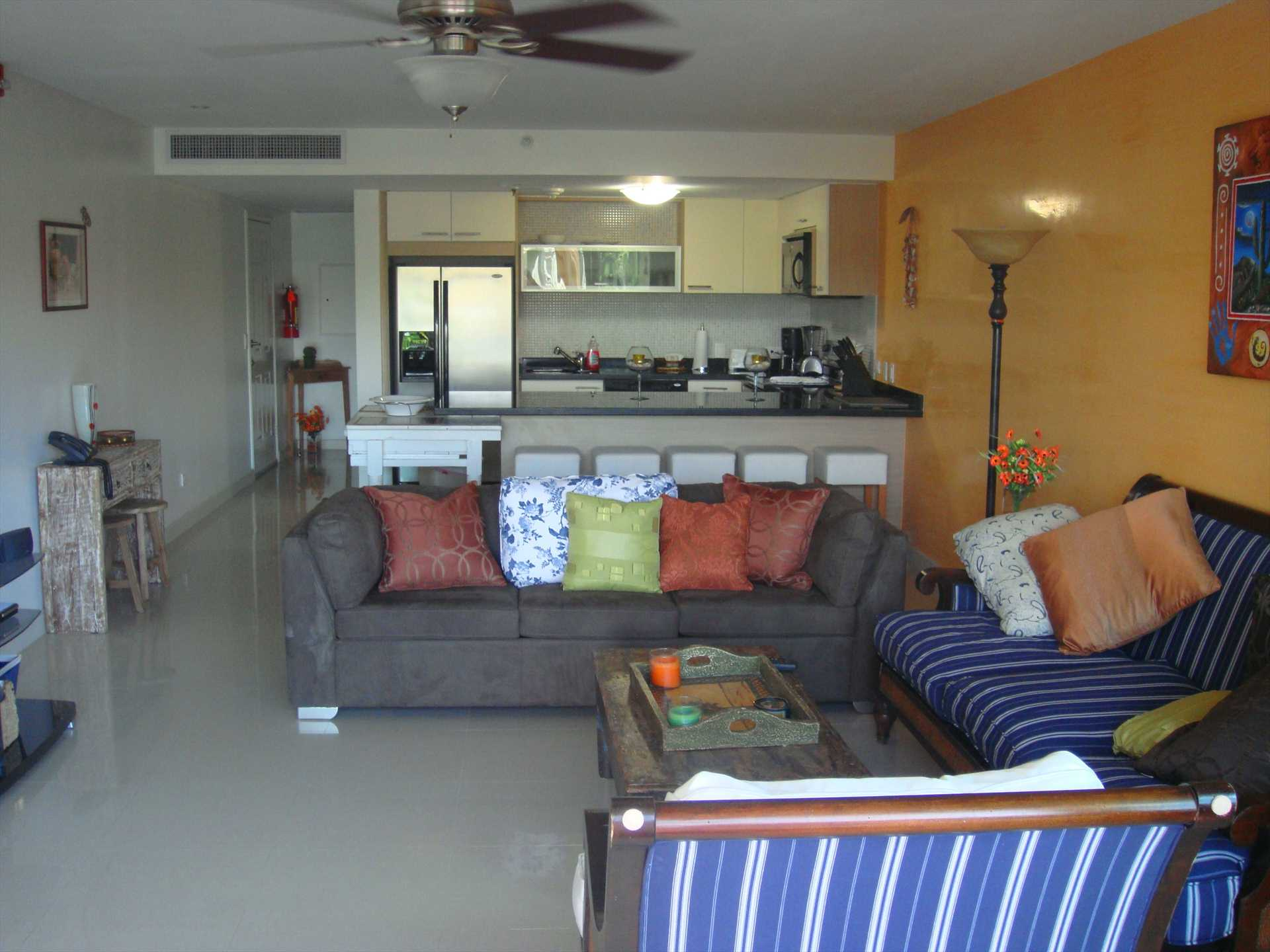 Spacious living with sofa, queen-size sofa bed and flatscreen HDTV!