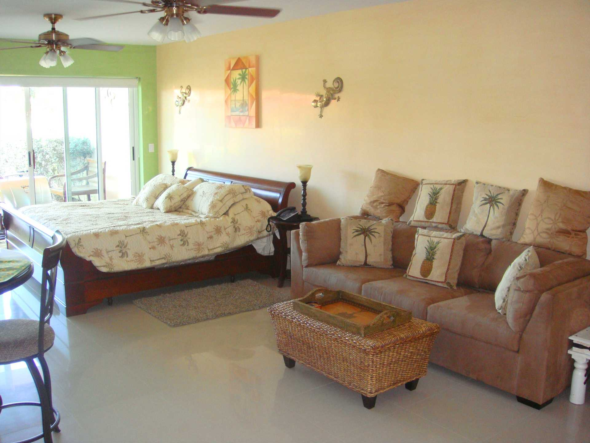 Studio room with king-size bed and queen-size sofa bed; private patio/deck.