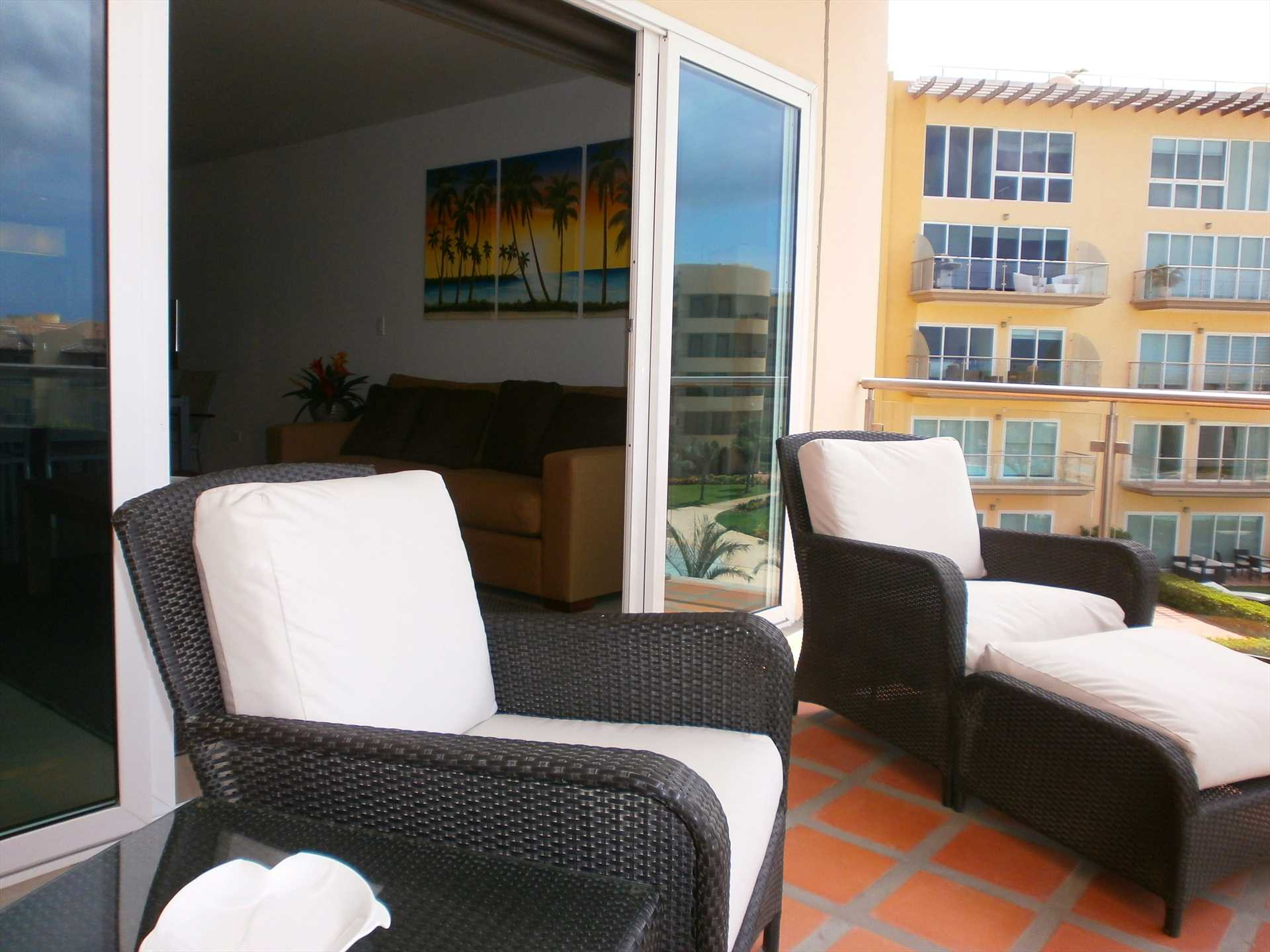 Lounging furniture on the balcony to enjoy the view!