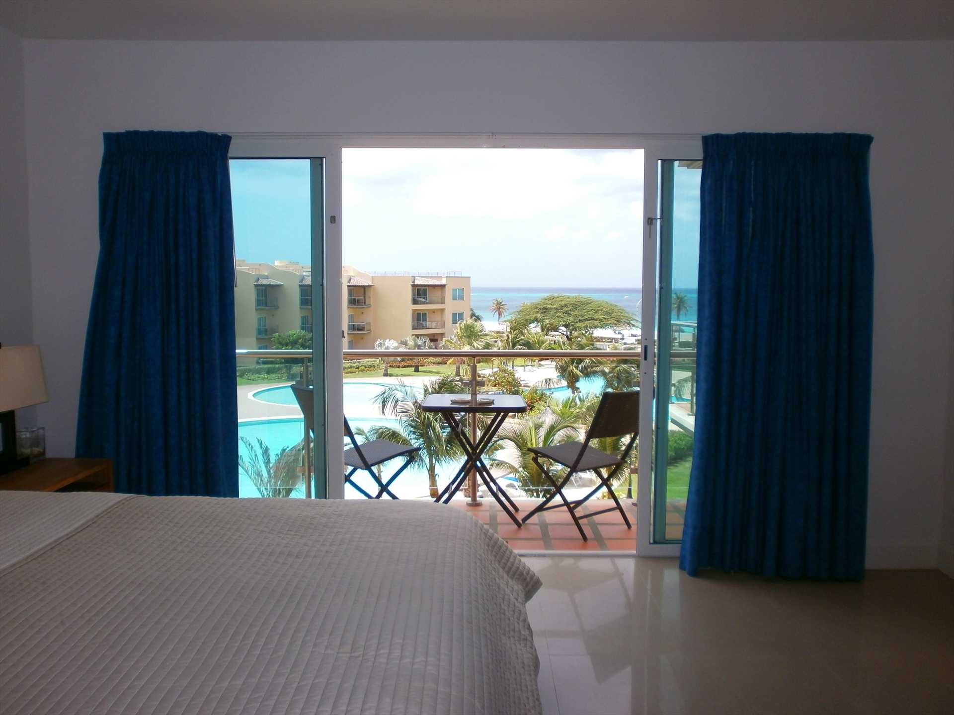 Master bedroom with also a balcony and ocean view