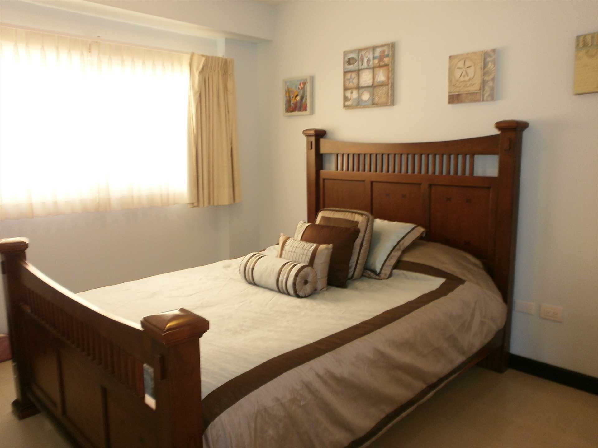 A third bedroom with comfortable queen-size bed in this unit!