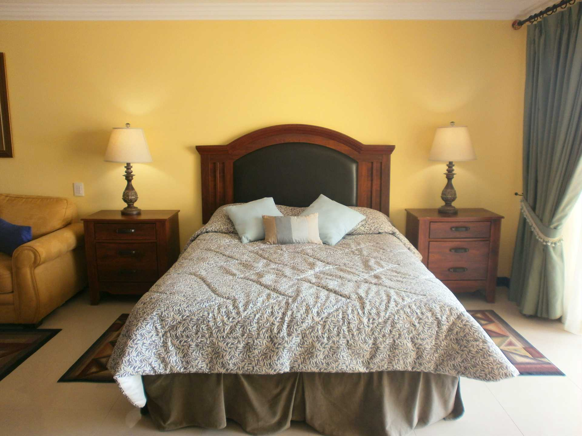 Queen-size bed in studio room.