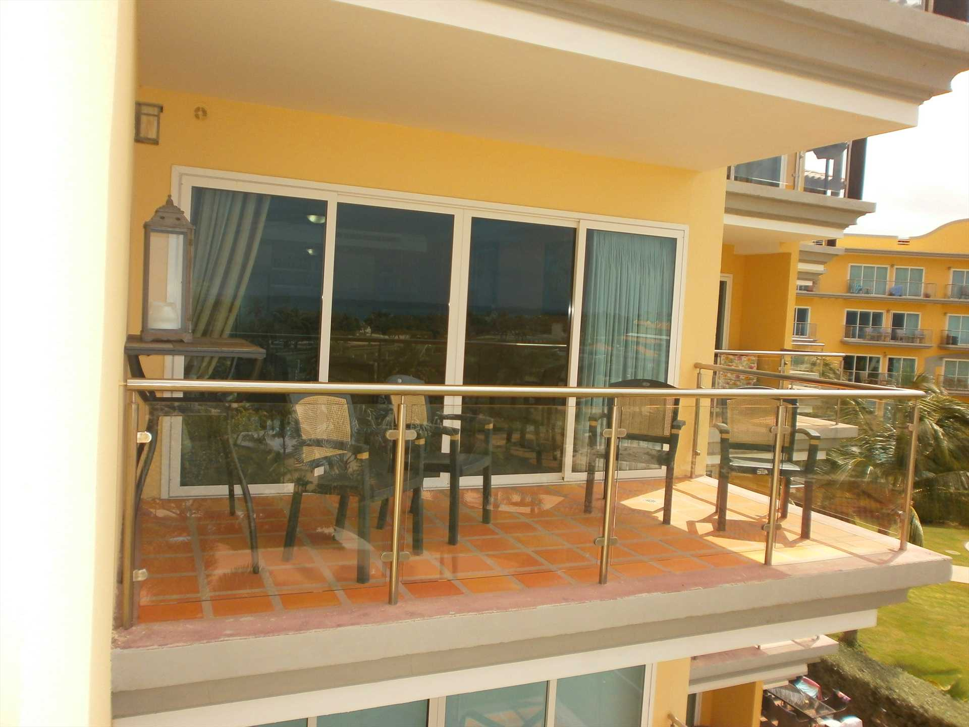 View of living area balcony from the master bedroom balcony.