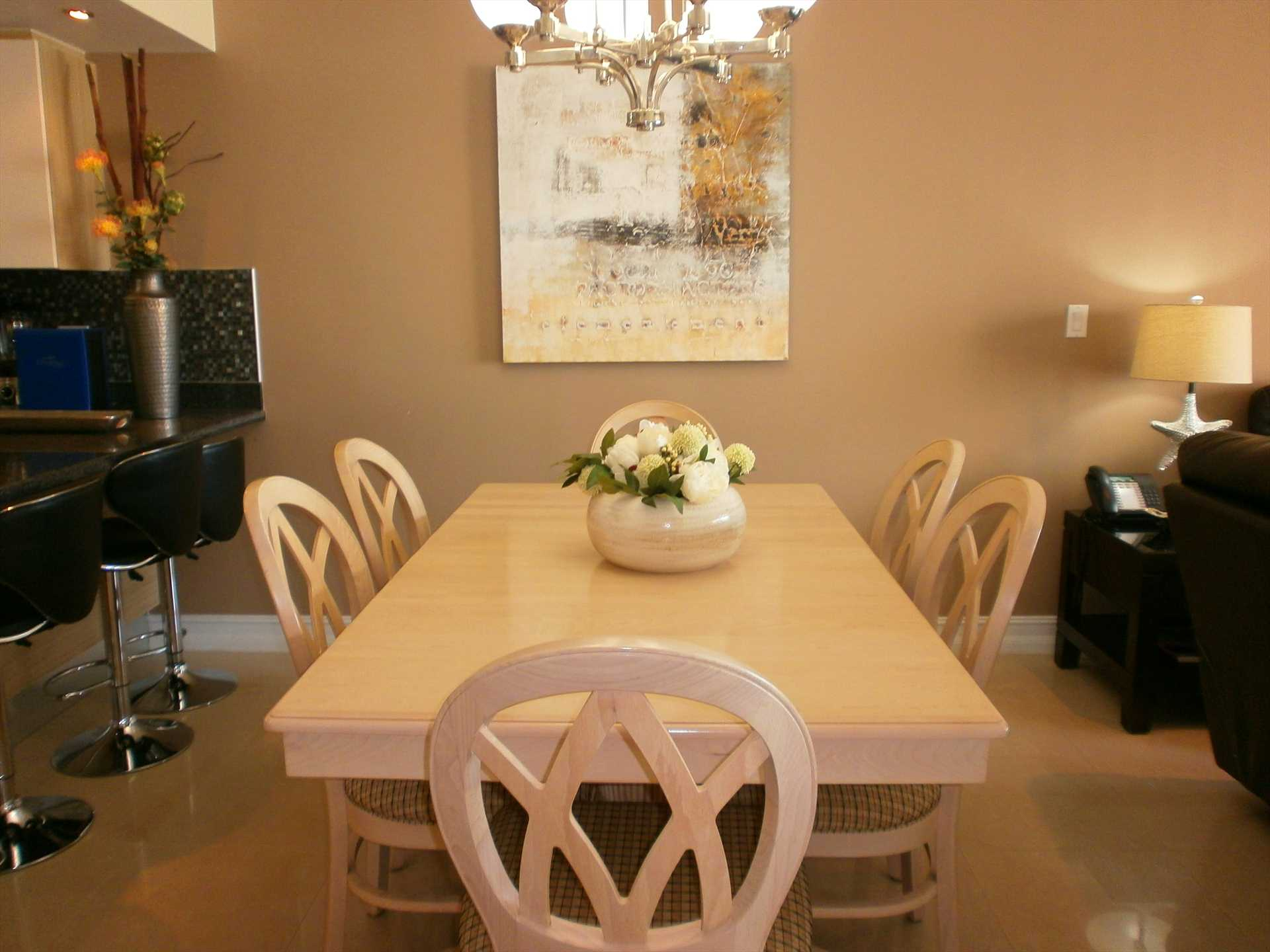 6-seat dining table next to kitchen