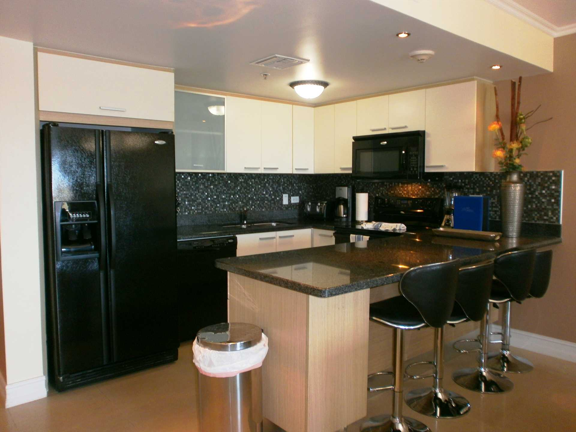 Top-of-the-line modern fully equipped kitchen with 4-seat bar-table