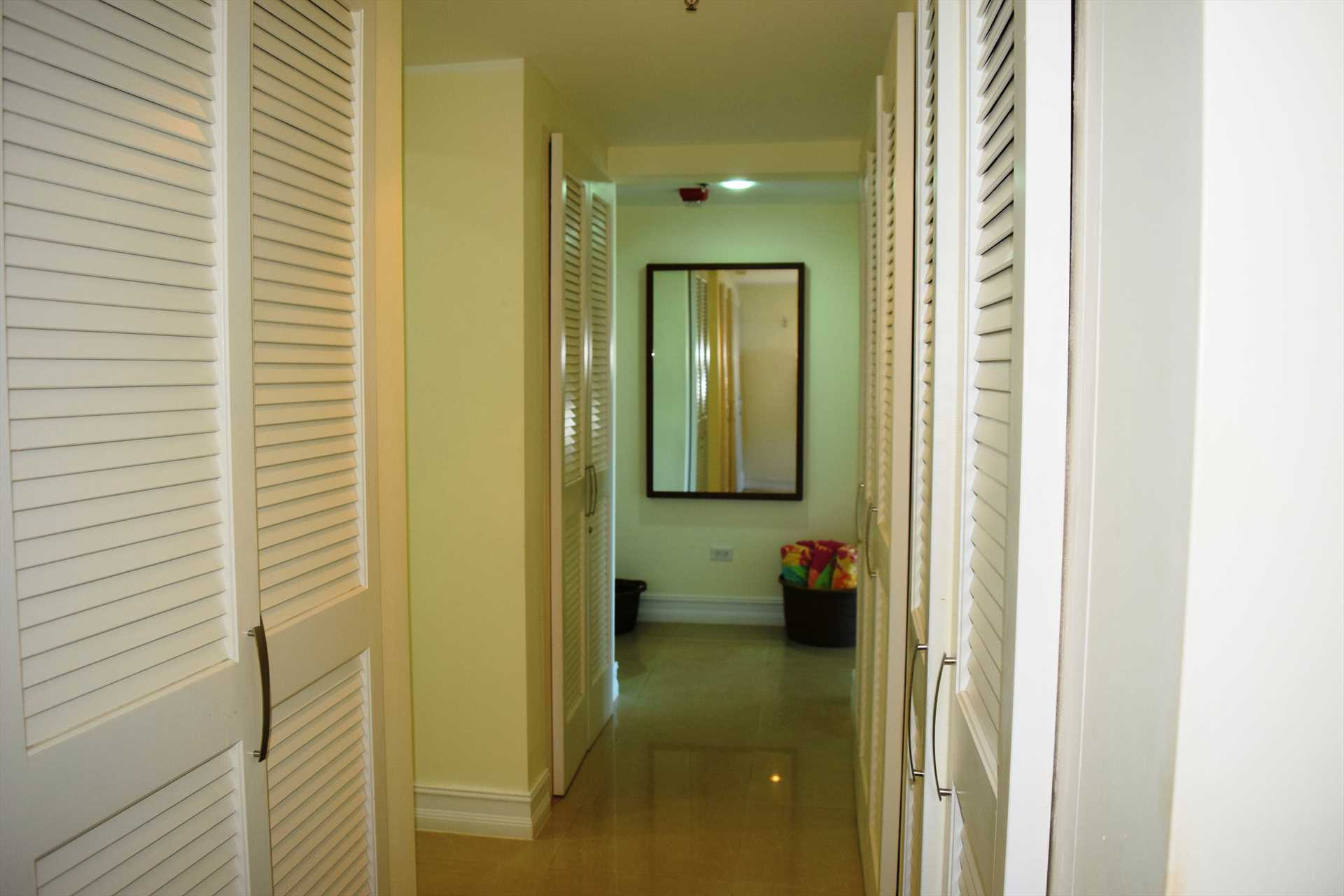 Corridor that lends access to bedrooms, bathrooms and laundry facilities