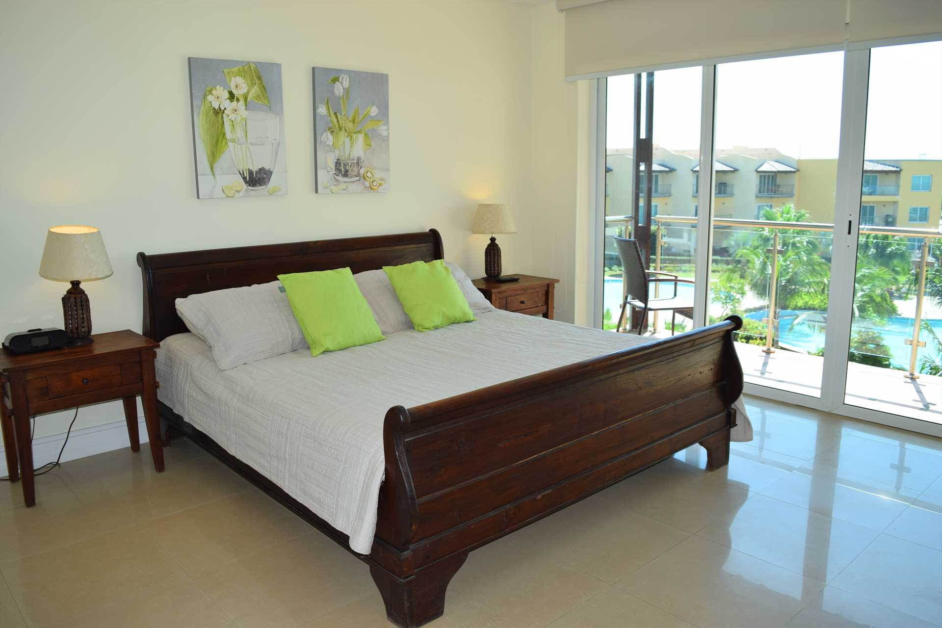 First master bedroom with king-size bed and private balcony