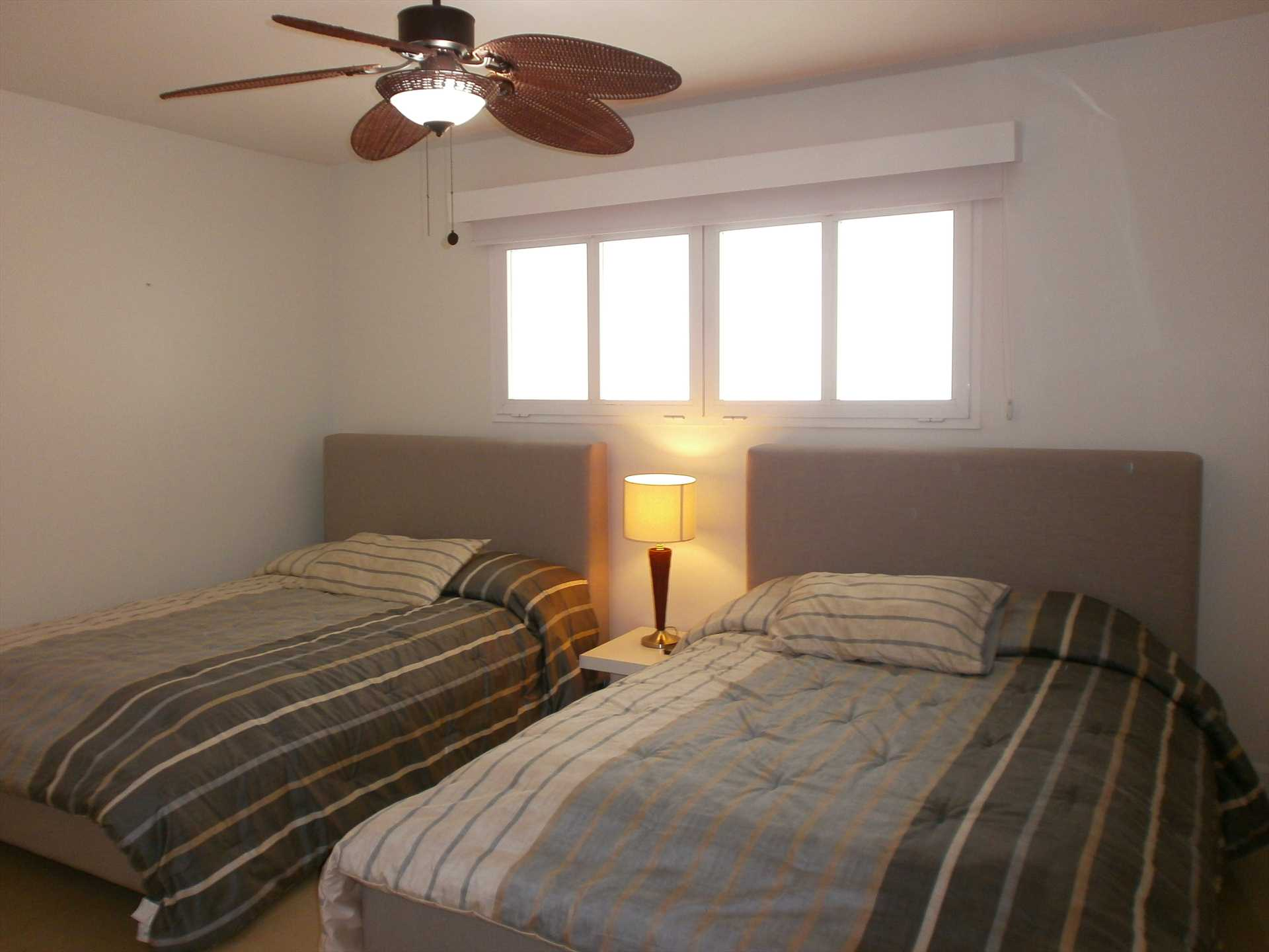 Two double-size beds in second bedroom.