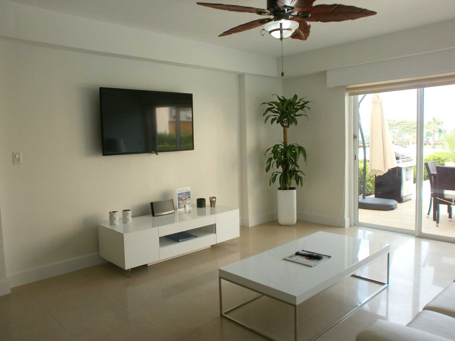 Your living room with modern sofa set with flat screen TV.