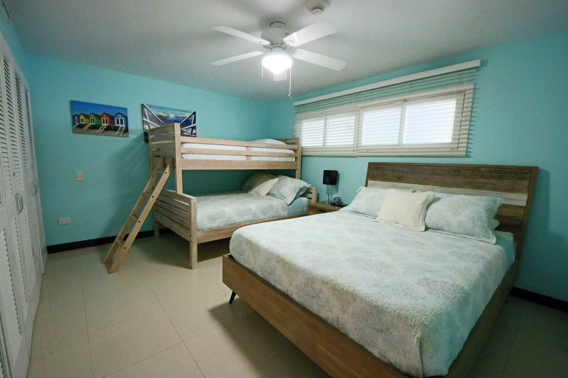 Second bedroom with a queen-size bed and a bunk bed (full-size and twin-size)