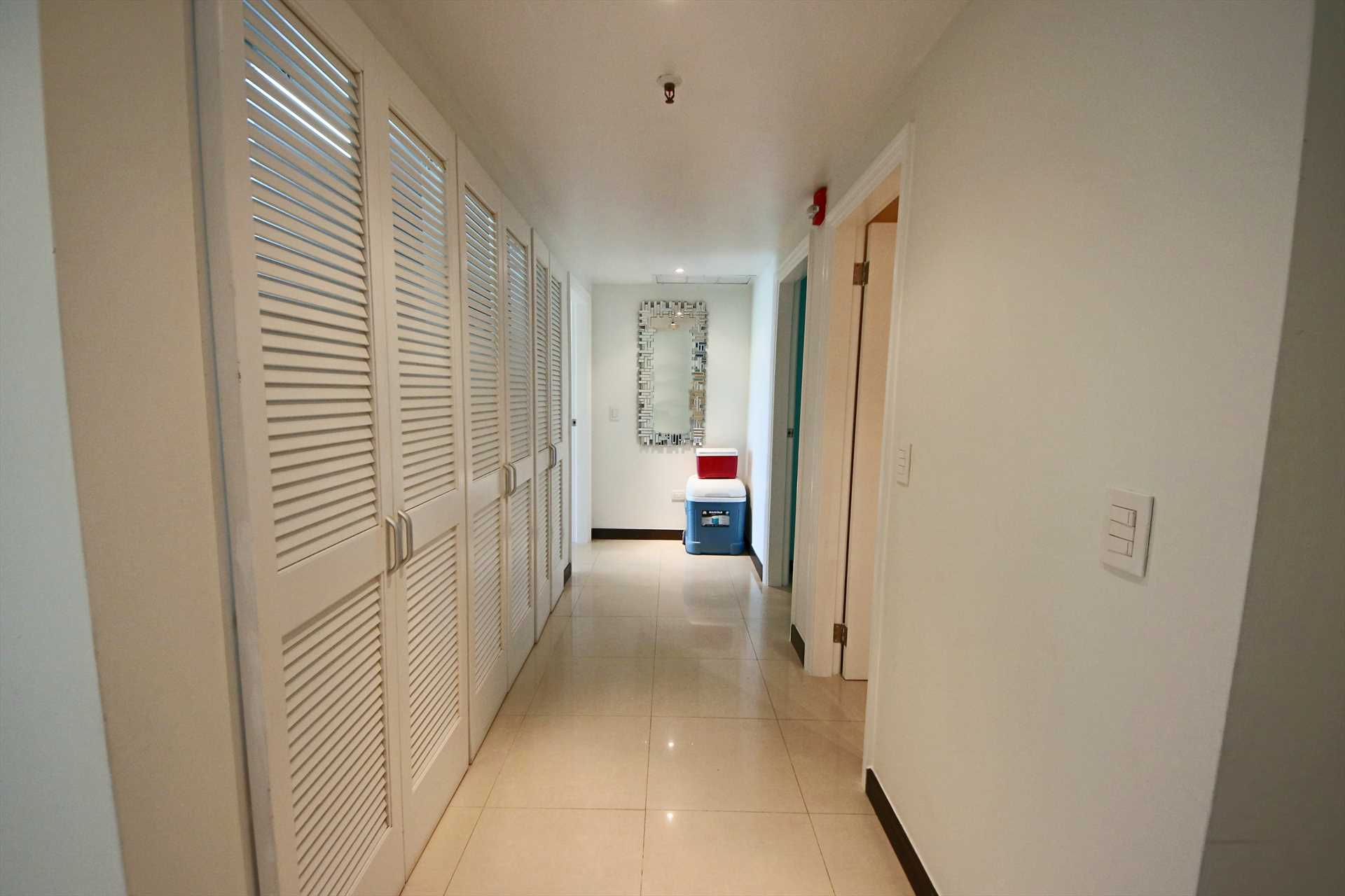 Entree flows into the laundry facility (washer/dryer) corridor towards the bedrooms