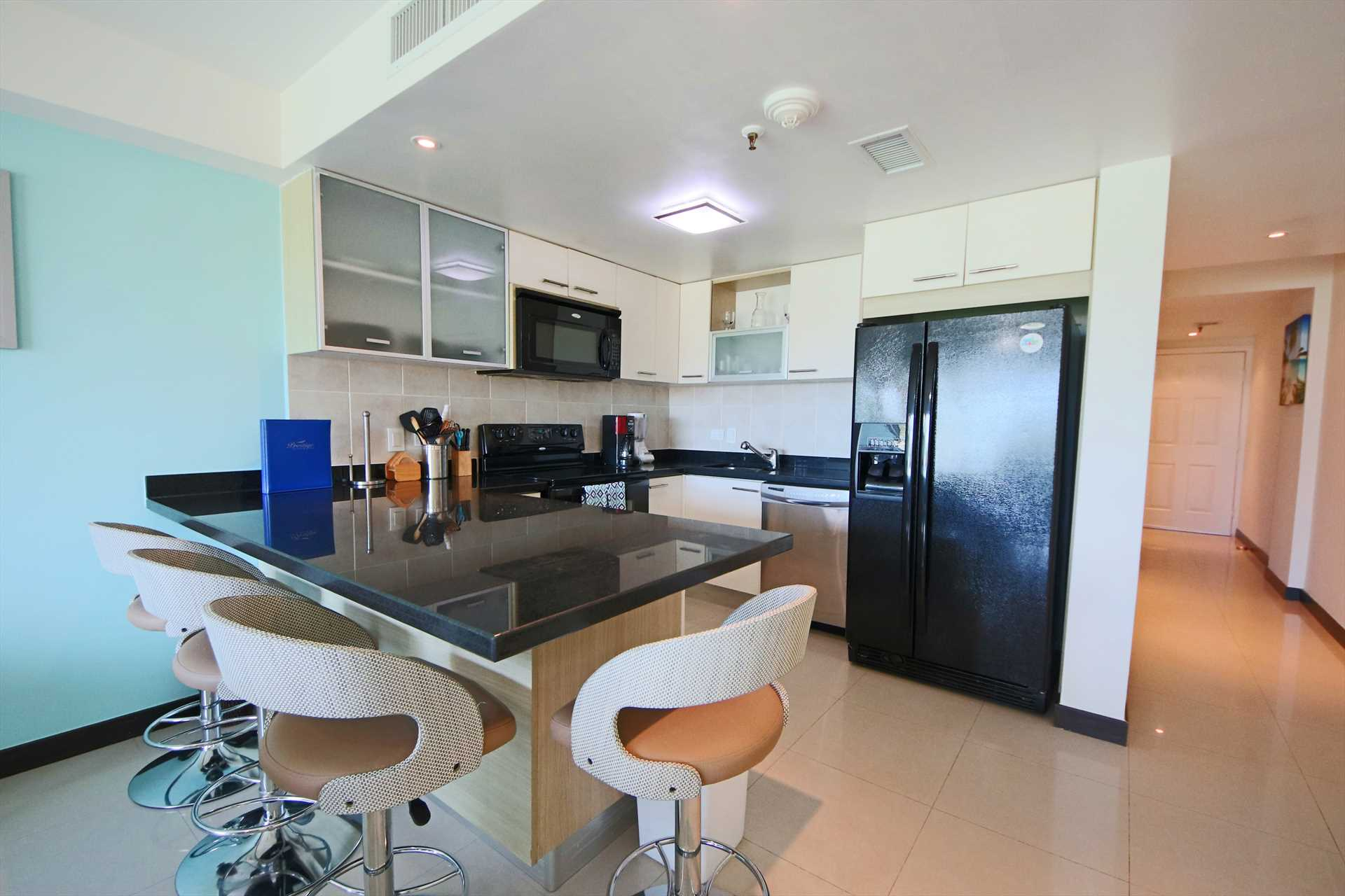 A full-size fully equipped kitchen with 4-bar seat