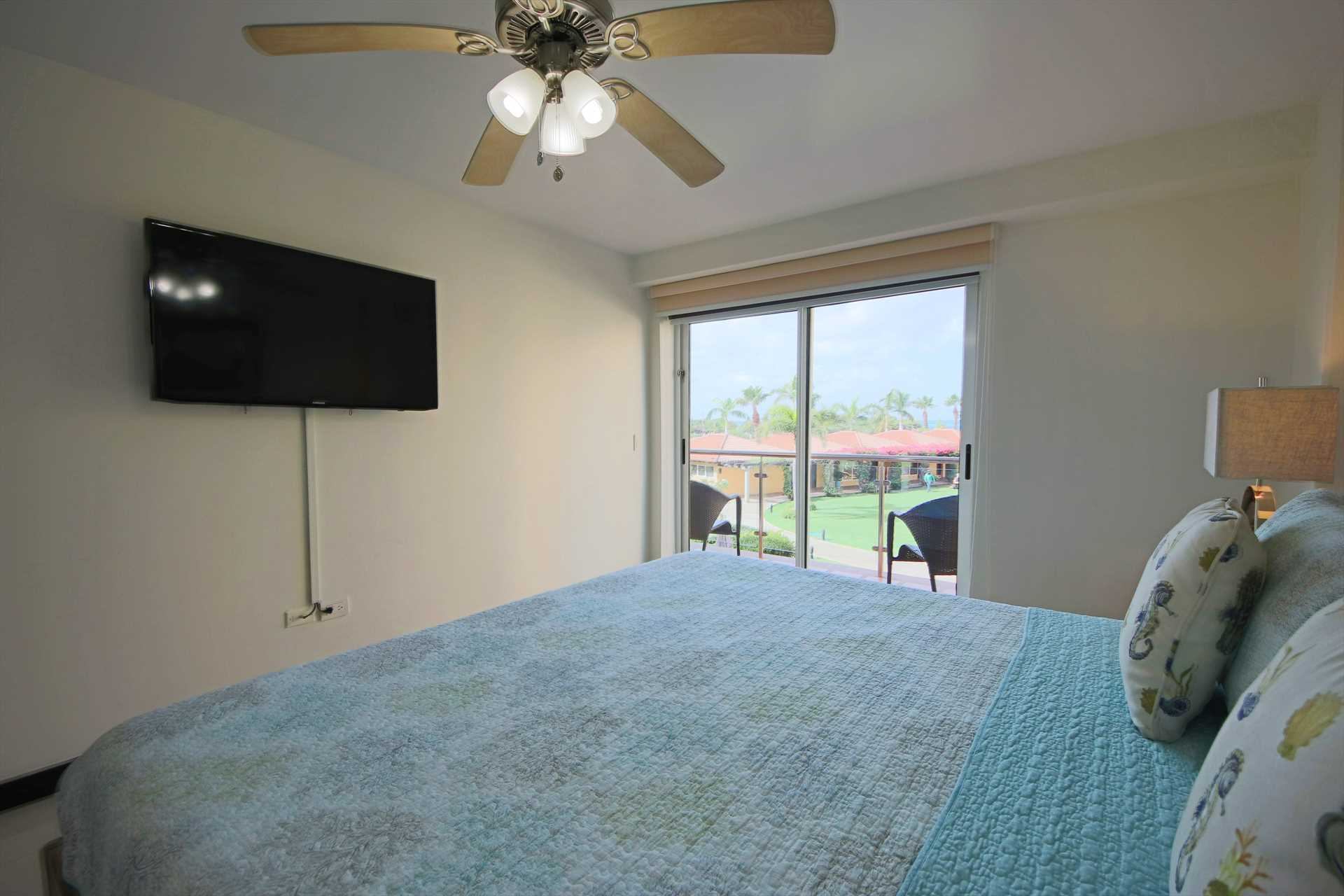 HDTV in master bedroom and access to balcony with ocean view
