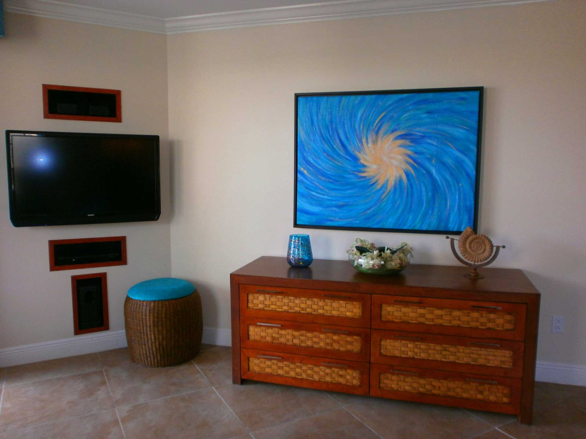 Living area with modern furniture and flatscreen HDTV.