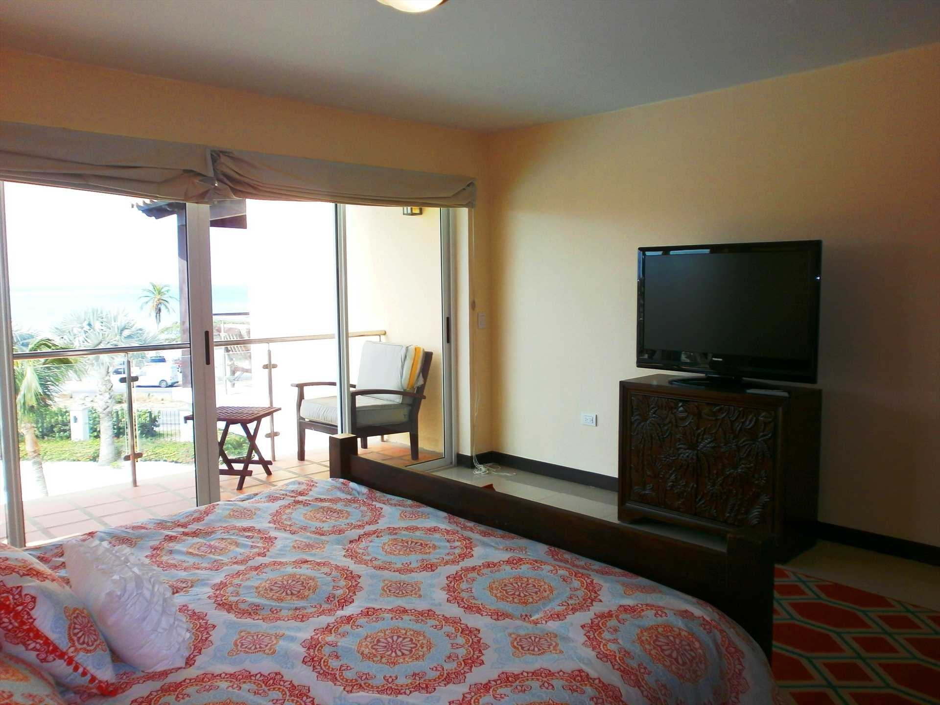 TV and balcony in master bedroom.