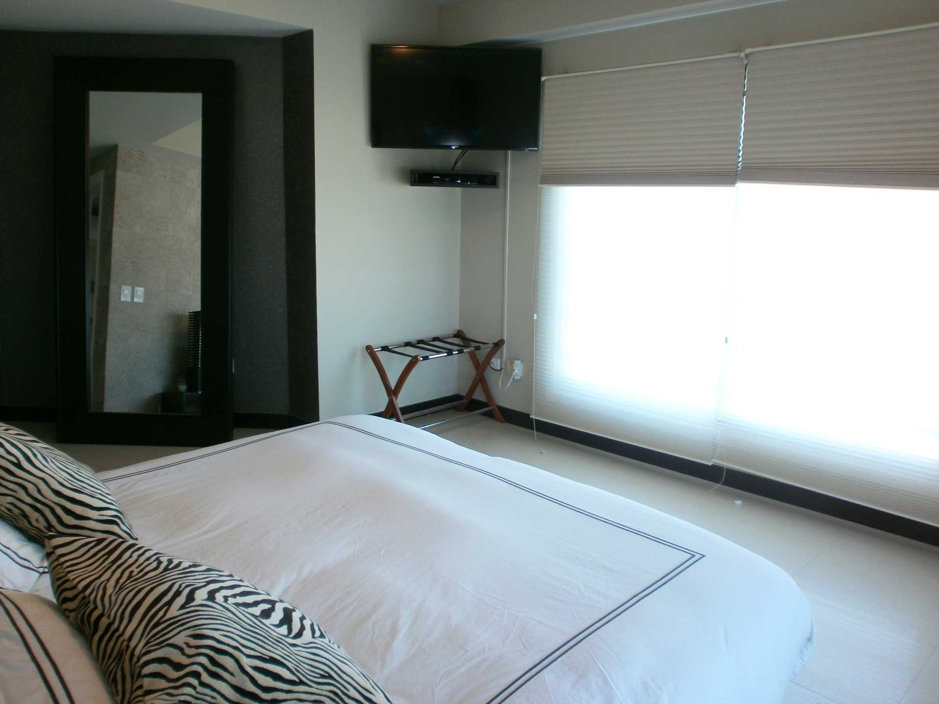 Master bedroom with HDTV, black-out and semi sheer system!
