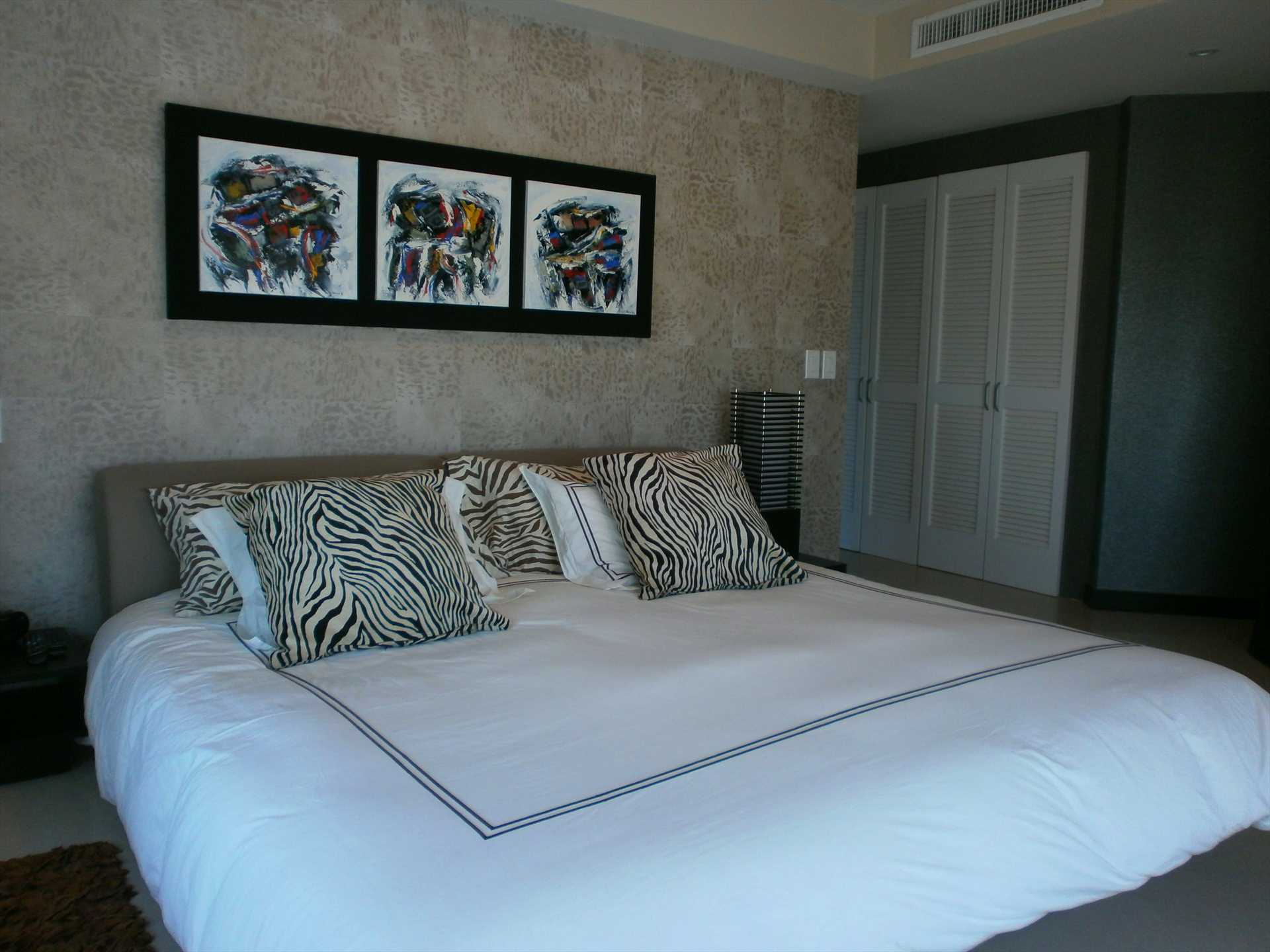 Master bedroom with king-size bed.