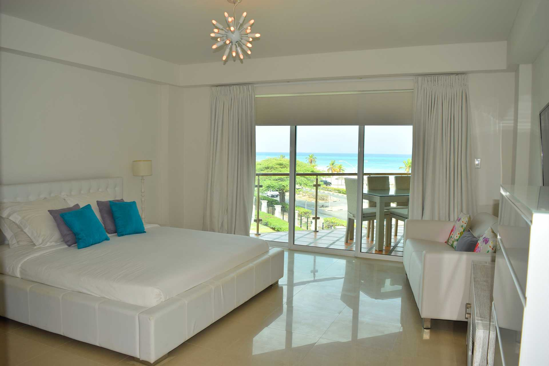 Master bedroom with king-size bed and balcony!