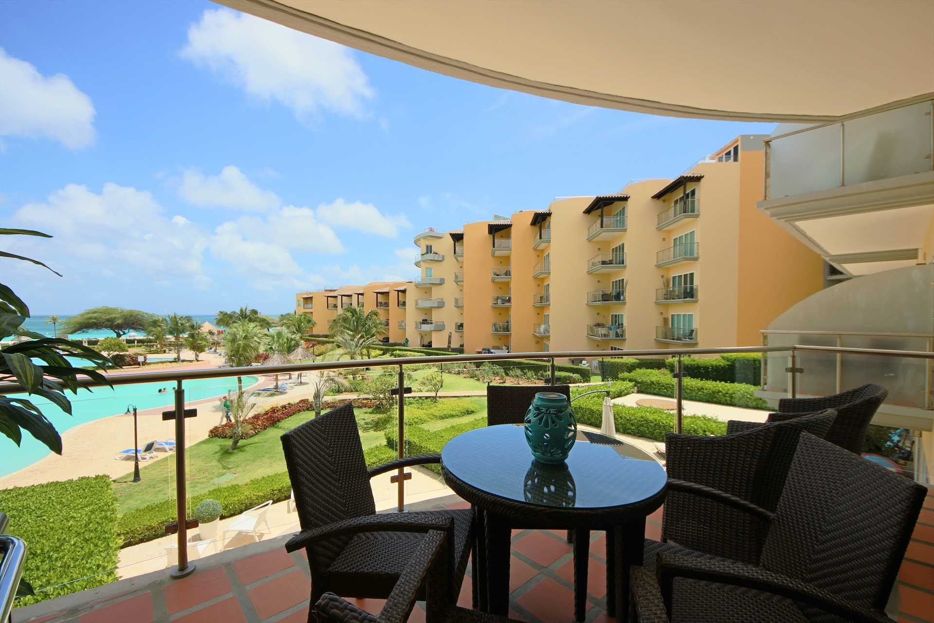 Enjoy Aruba's sunsets on your own balcony with pool and ocean view!