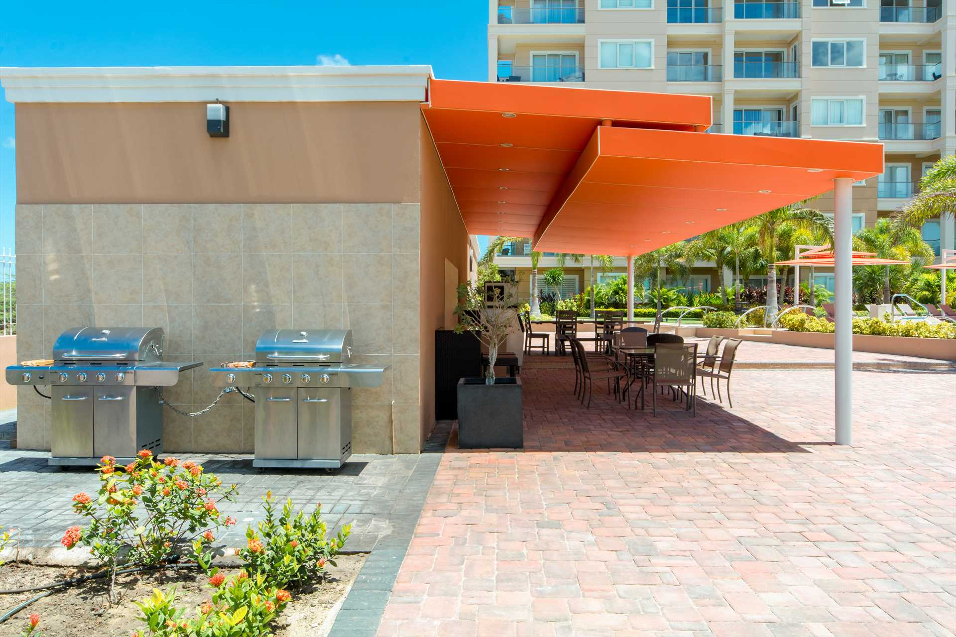The communal alfresco dining space with BBQ-grills at the LeVent resort