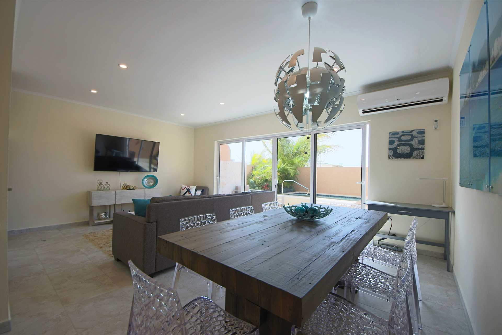 Living area with access to your private back patio with swimming pool