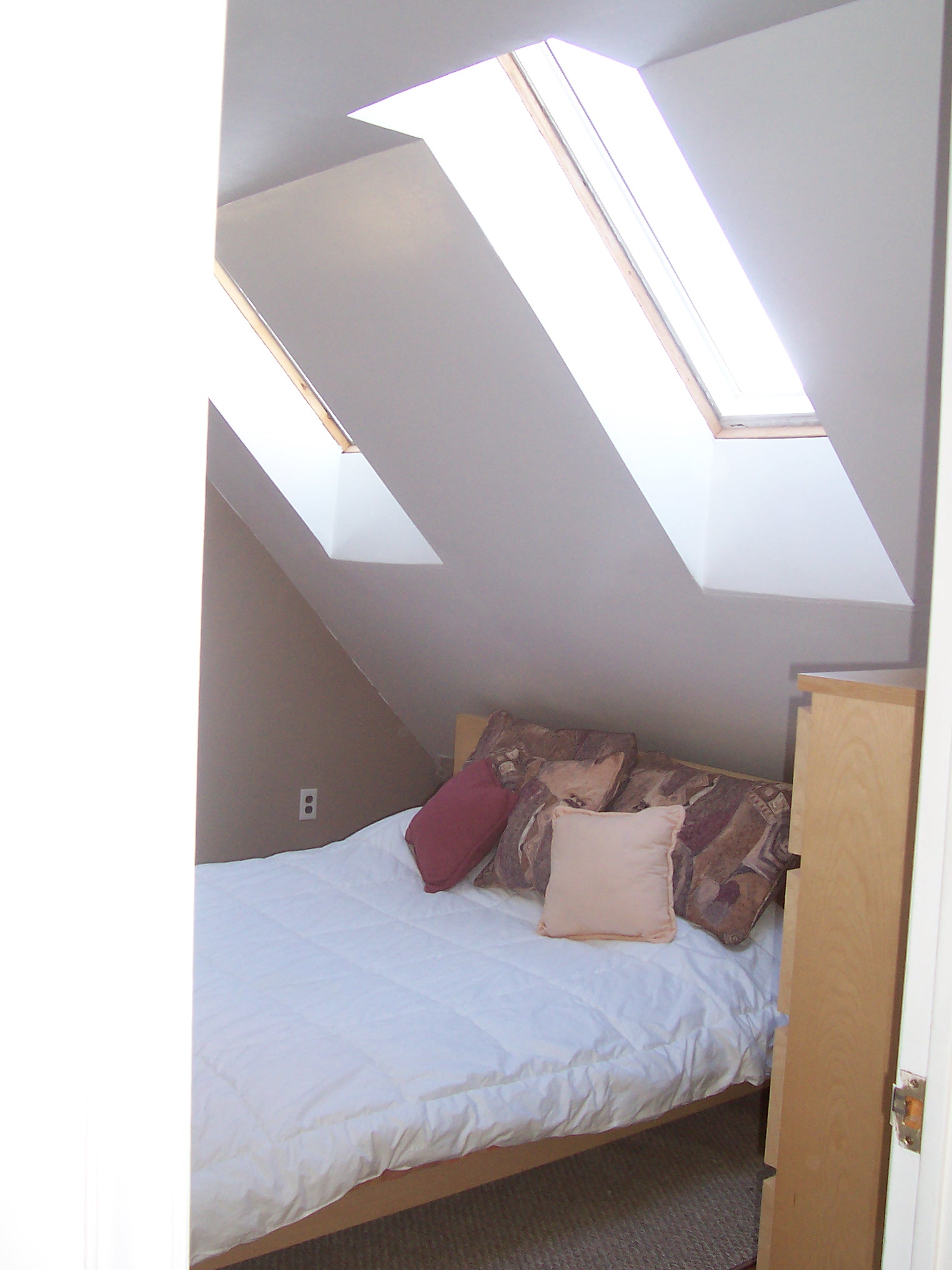 One of the bedrooms with skylight.