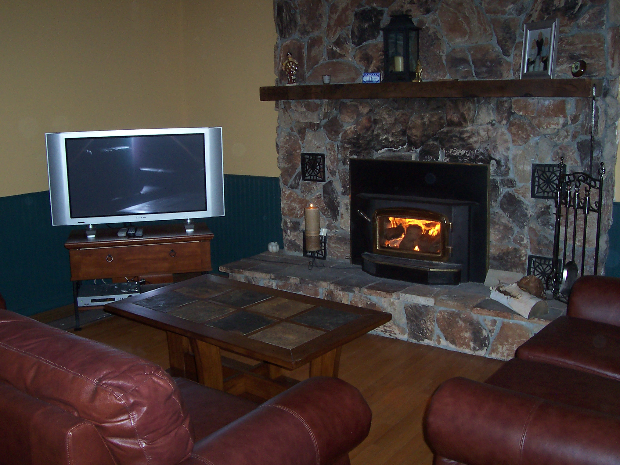 Another view of living room/fireplace.