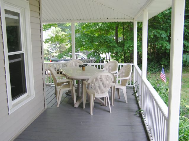 DINE OUT ON PORCH FACING LAKE FOR MAXIMUM VIEW OF SUNSETS NEAR WEBER GRILL
