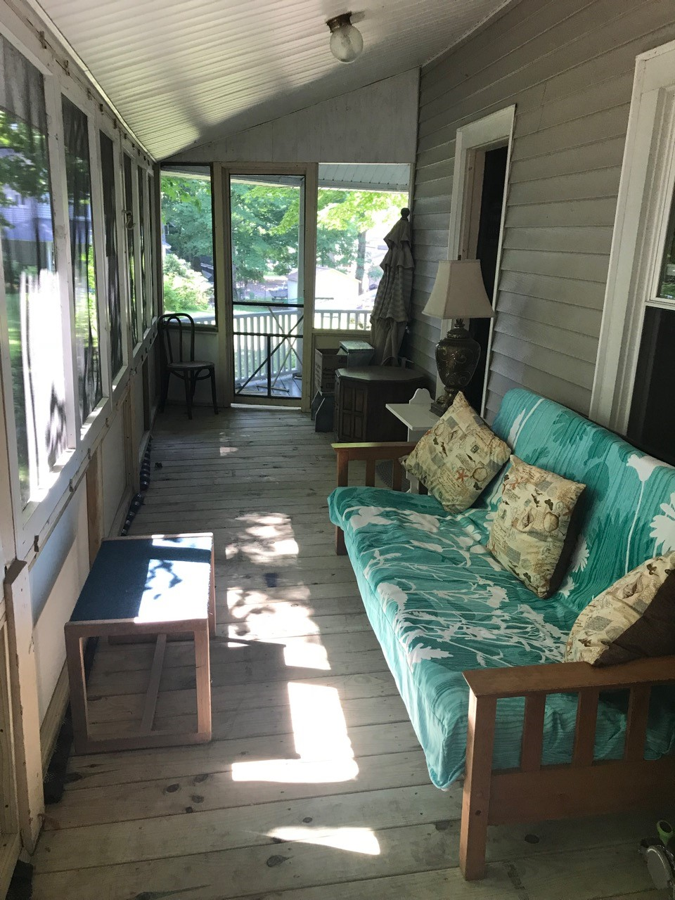 ENCLOSED PORCH IN BACK OF HOME FACING PRIVATE WOODS
