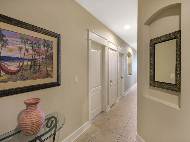 Foyer area with picture on the wall - White door with white trim