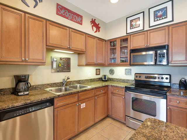 Kitchen cabinets - sink and dishwasher with microwave and granite counter tops