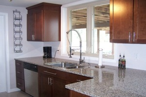 Granite counter tops with Mohagany cabinets