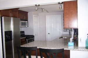 Nice Kitch with Stainless steel and Granite counter tops in the kitchen.