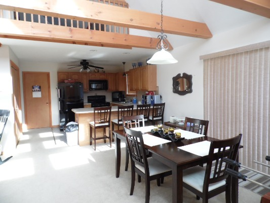Kitchen with Dinning room table wooden beams over head