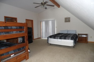 Bedroom with bunk beds and queen size bed -Ceiling fan