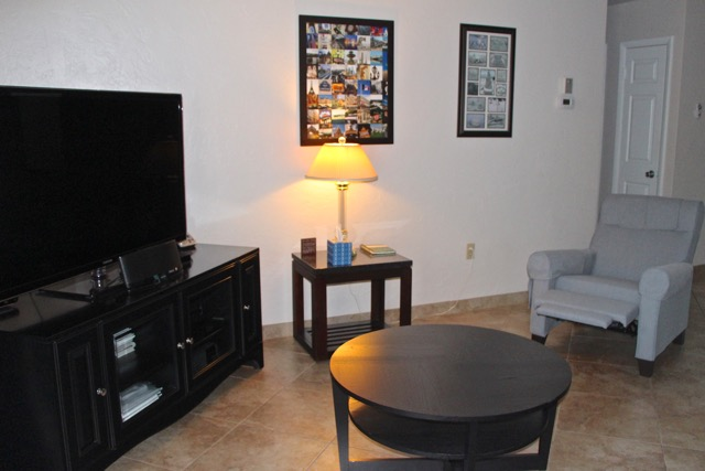 Living room area with large flat screen.